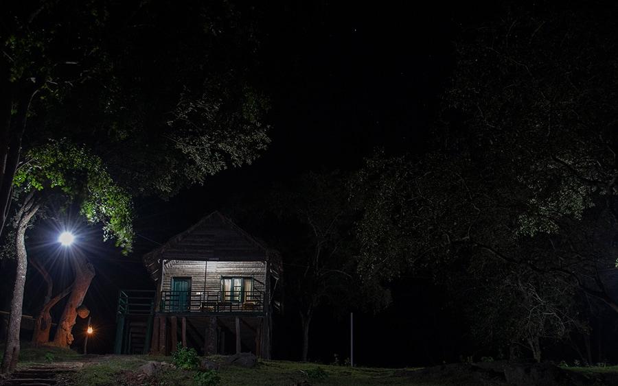 Our log hut, Chamundi at night.